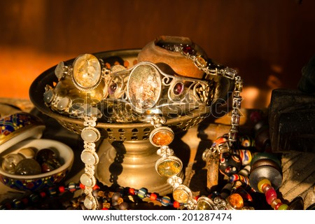 Still life with Jewelry old silvers in old brass tray,Concept of old treasures - stock photo
