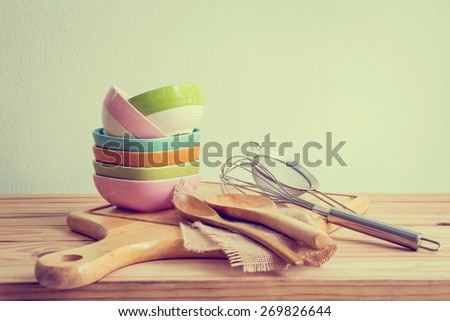 Still life with kitchenware on wooden over grunge background - stock photo