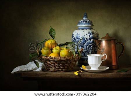 Still life with mandarins and a Delft vase (textured for artistic effect) - stock photo