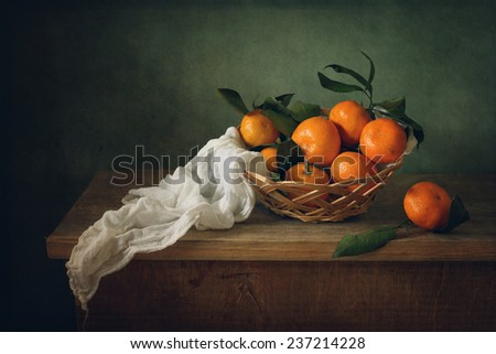 Still life with mandarins and drapery - stock photo