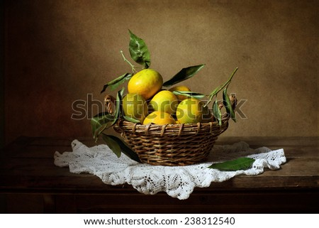 Still life with mandarins in a basket - stock photo