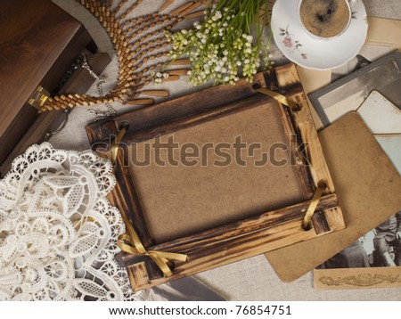 Still life with old album for pictures - stock photo