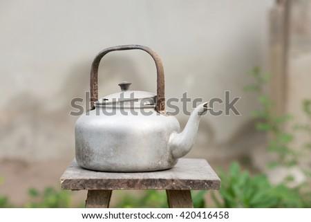still life with old aluminium kettle, Select focus aluminium kettle - stock photo