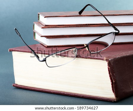 Still-life with old books and glasses