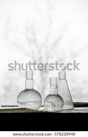 Still life with old flasks in an abandoned chemical laboratory