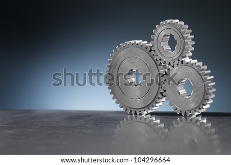 Still life with Old metallic cog gear wheels. - stock photo