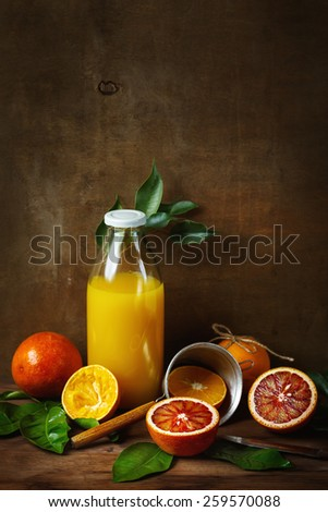 Still life with orange fruit and juice on wooden table. Painting style. Selective focus. Space for your text. - stock photo