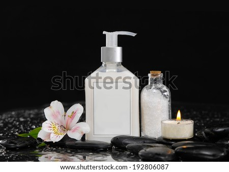 Still life with orchid ,massage oil, candle and zen stones