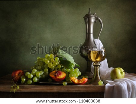 Still life with peaches and green grapes - stock photo