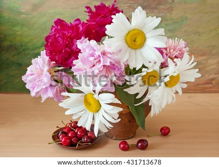 Still life with peonies and chamomiles bunch and sweet cherry on painting background - stock photo