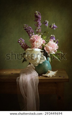 Still life with peonies and lupins - stock photo