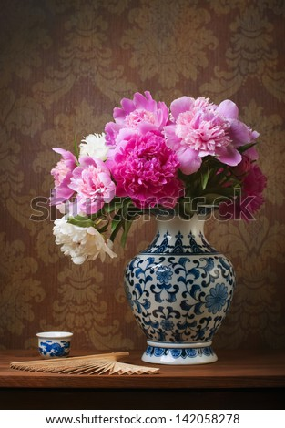 Still life with peonies in a chinese vase - stock photo