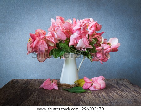 Still life with pink flowers on wooden table over grunge background, Dona Queen Sirikit Flower