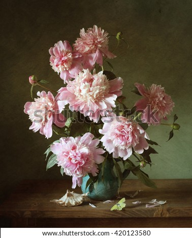 Still life with pink peonies and a shell (textured for artistic effect) - stock photo