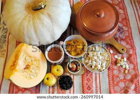 Still life with pumpkin, apples and onions - stock photo