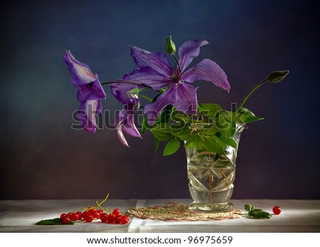 still life with purple flowers in the vase and currant