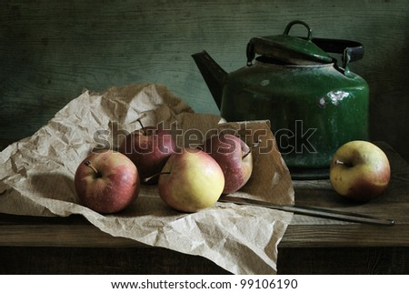 Still life with red apples and a very old kettle - stock photo