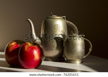 Still Life with Red Apples and Old Oriental Silver Coffee Set.Focus on the Pot - stock photo