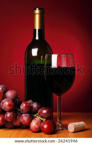 Still-life with red wine and bunch of grapes