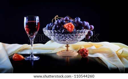 Still life with red wine and grapes - stock photo