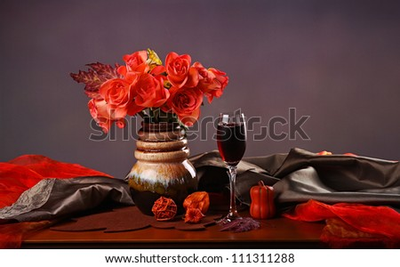 Still life with red wine and roses - stock photo