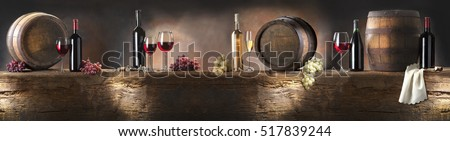still life with red wine and white wine on old wood