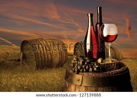 still life with red wine on sunset - stock photo