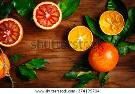 Still Life with Ripe Juicy Citrus Fruits on Wooden Table Ready for Eat. Vibrant Colors, Top View, Space for Text. - stock photo