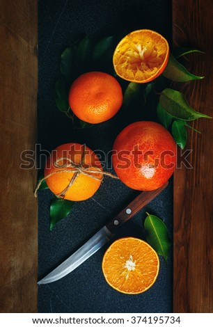Still Life with Ripe Juicy Citrus Fruits Ready for Eat. Whole, Half and Squeezed Oranges. Vibrant Colors, Vertical Composition. Selective Focus. - stock photo