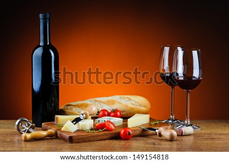 still life with romantic dinner, various gourmet cheese and red wine