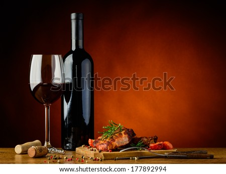 still life with romantic dinner with gourmet grilled steak and red wine - stock photo