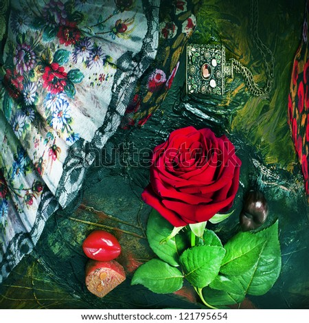 Still life with rose and a fan. - stock photo