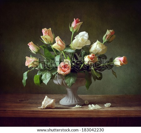 Still life with roses and a shell - stock photo