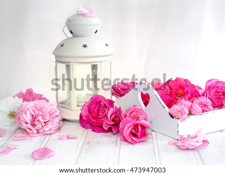 Still life with roses and a white lantern