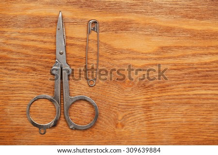 Still life with scissors, thread, pins. tool tailor. - stock photo