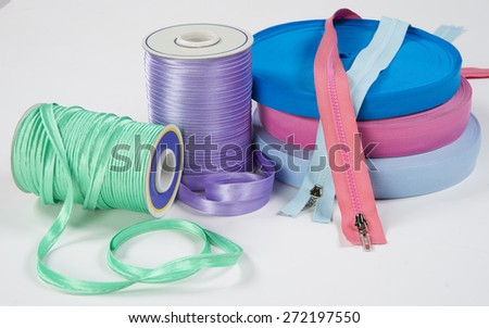 Still life with sewing accessories, isolated on white background - stock photo