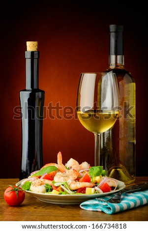 still life with shrimp seafood salad and white wine - stock photo