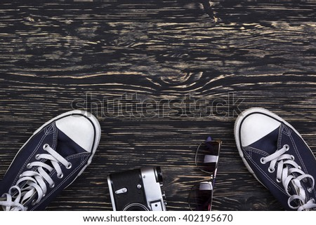 still life with sneakers, camera and sungalsses - stock photo