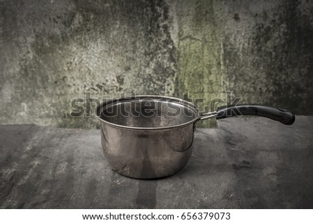 still life with steel pot on the wooden table - cookware