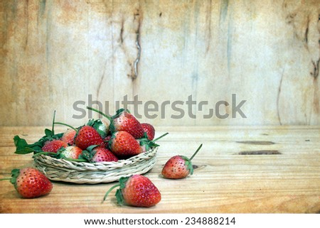 Still life with strawberry on wooden table - stock photo
