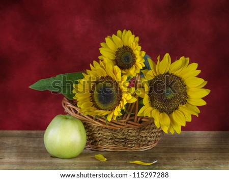 Still life with sunflowers and apples - stock photo