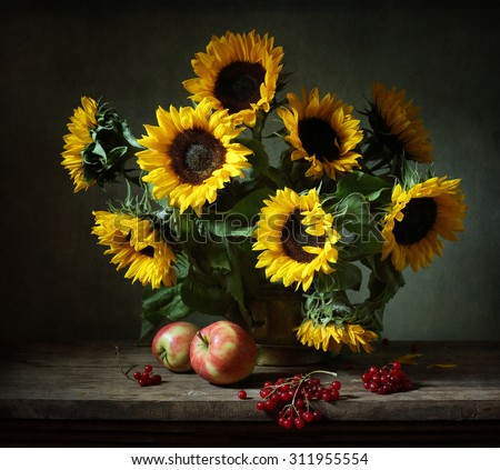 Still life with sunflowers and apples (textured for artistic effect) - stock photo