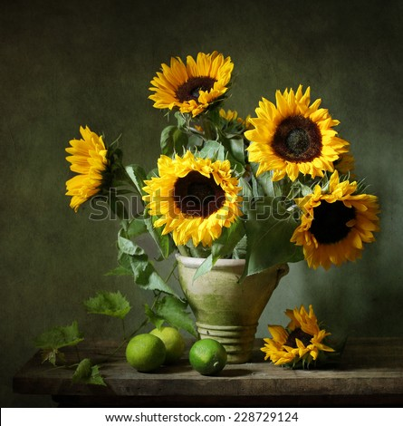 Still life with sunflowers and lemons - stock photo