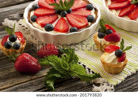 Still life with  tasty cake and  fresh berries - stock photo