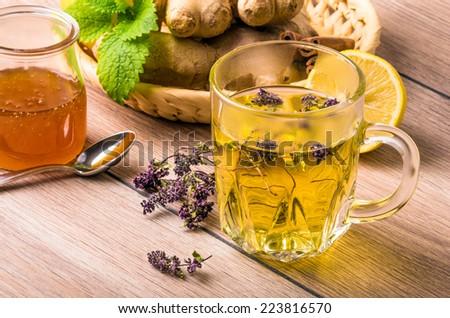 Still life with tea. Natural herbal tea with honey and lemon. Thymus serpillum. - stock photo