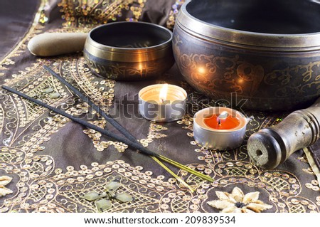 Still life with tibet singing bowls and candles - stock photo