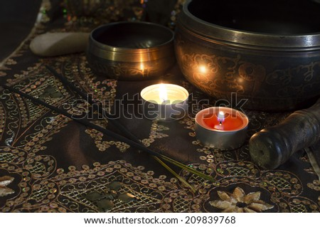Still life with tibet singing bowls in candle light - stock photo