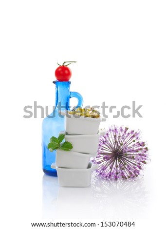 Still-life with tomato and sprouts in cup - stock photo