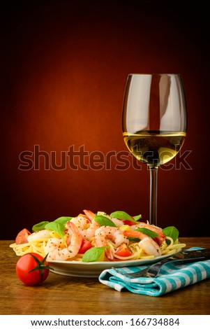 still life with traditional spaghetti with shrimps and white wine