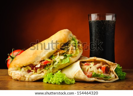 still life with traditional turkish doner kebab, shawarma and cola drink - stock photo